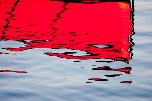 Red reflections on the water