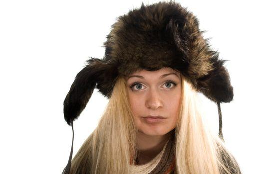 Beautiful girl in fur cap