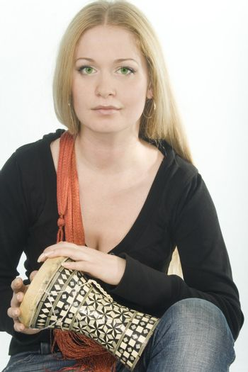 green-eyed pretty blonde with djembe