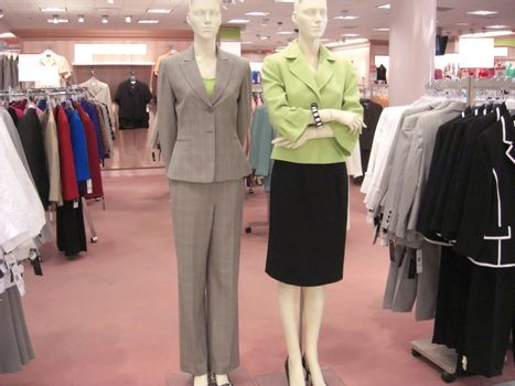 A store department is displaying a whole range of women's designer clothes, some on mannequins.