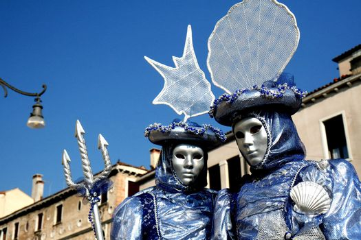 A masked couple,dressd in blue