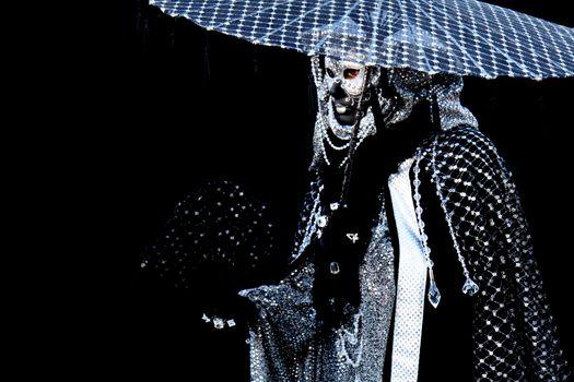 A masked man at Venice