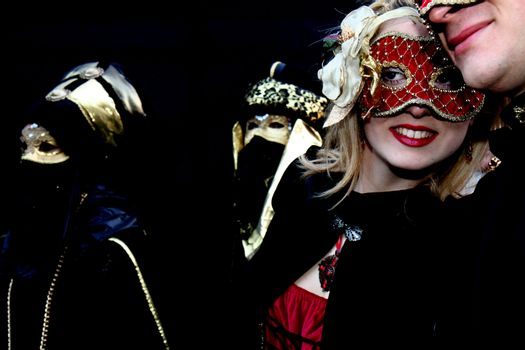 Lady with a red mask at Venice