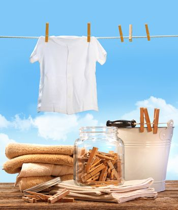 Laundry day with towels and t-shirt on clothesline