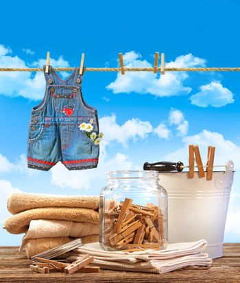 Laundry day with towels and child's jeans on clothesline