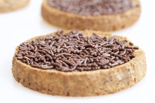 Close up chocolate sprinkles on toast.