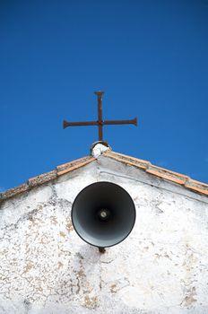cross and loudspeaker