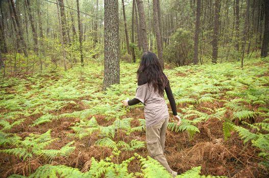 woman between fern