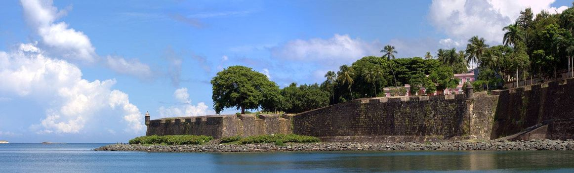 The city boundary and old decaying wall of El Morro fort located in Old San Juan Puerto Rico.
