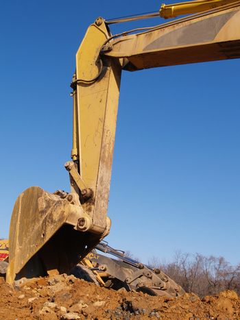 back hoe construction equipment with blue sky in the background