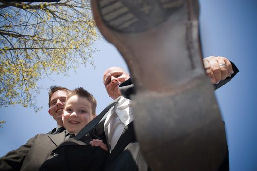 A groomsman in a wedding party decides to stomp on the photographer.  This could be used for a variety of concepts.