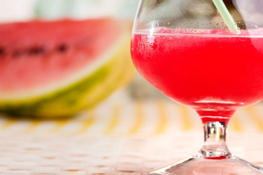 A red watermelon drink on a picnic table