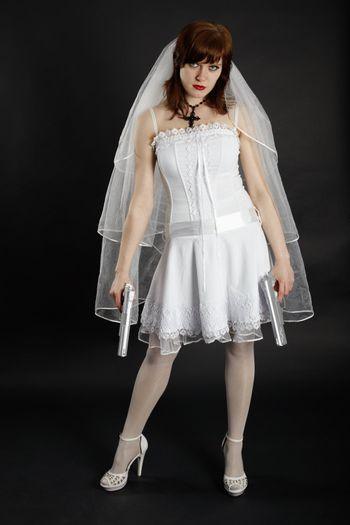 Bride in white dress armed with two pistols