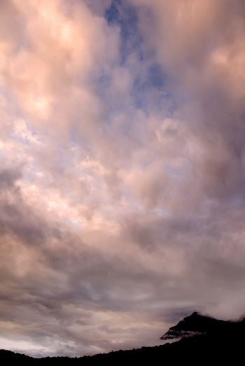 clouds over hill
