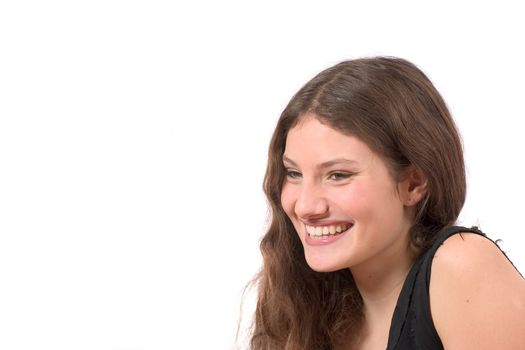 Beautiful confident teenager on white background laughing