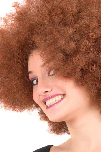 Lovely young teenager with red afro wig pulling faces