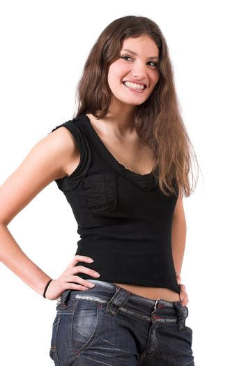 Beautiful teenager standing in a confident pose with her hands on her hip and smiling
