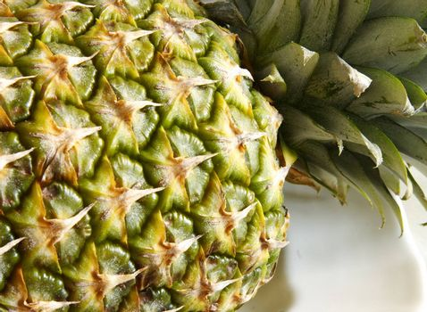 whole fresh pineapple on a plate