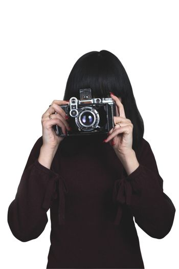 young girl with old film camera