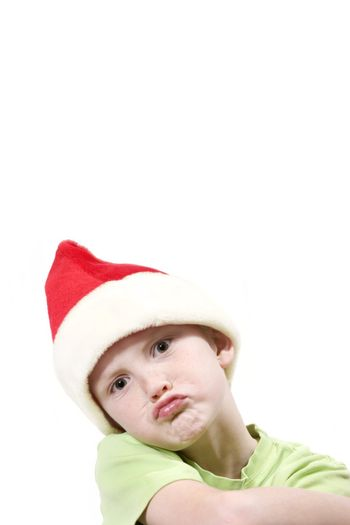 boy isolated with santa hat and expression