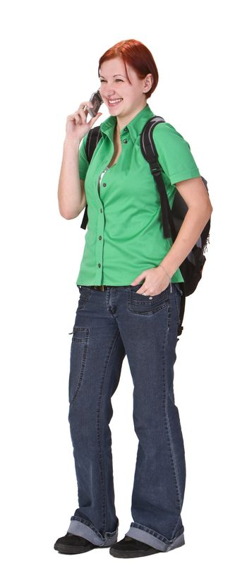 Happy young teenage girl talking on a mobile phone.