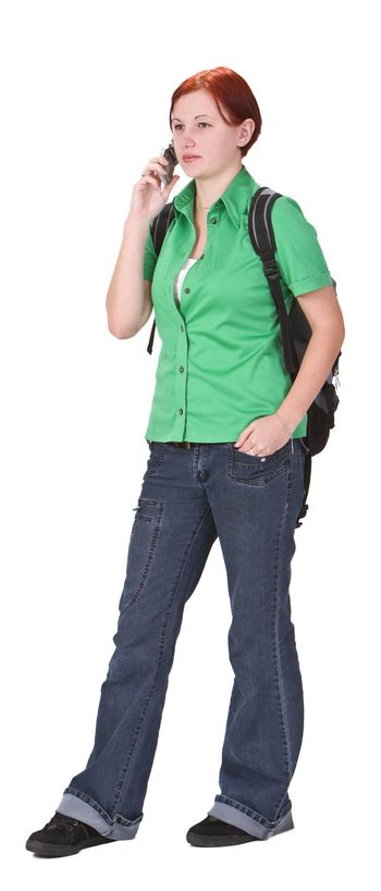 Young teenage girl talking on a mobile phone. Shot with Canon 70-200mm f/2.8L IS USM