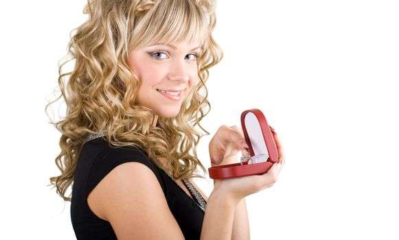 young friendly blond girl holding box with wedding ring