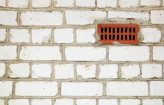 Brick wall with primitive ventilation