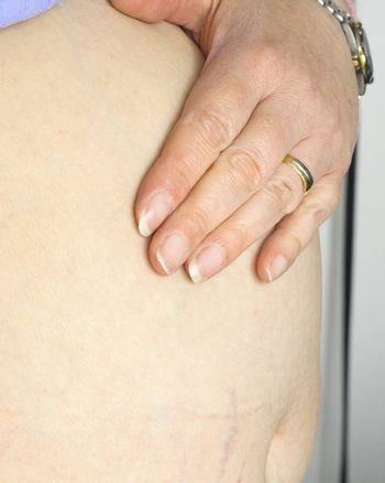 a pregnant woman with her hand on the stomach