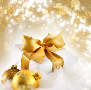 Gold ribboned gift with festive holiday background