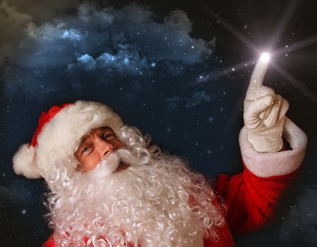 Santa pointing with magical light to the sky