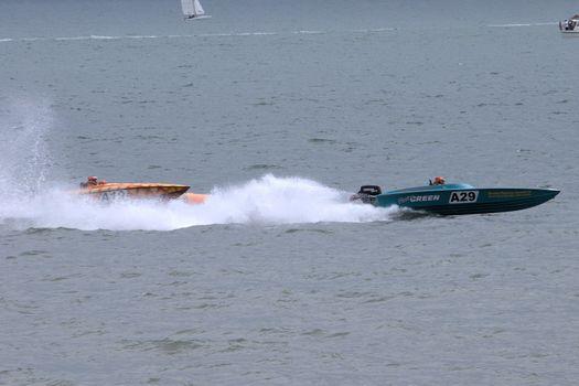 Two powerboats racing