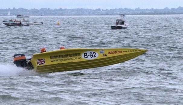 Yellow speedboat racing