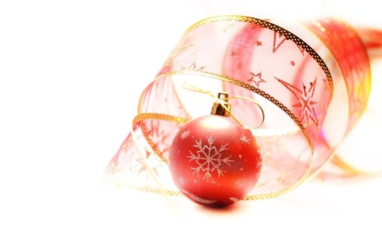 Red Christmas ball with rer ribbon isolated on white background