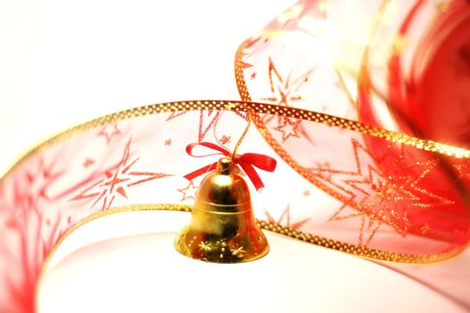 Christmas bell toy with red ribbon on white