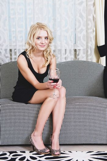 Woman with goblet of wine