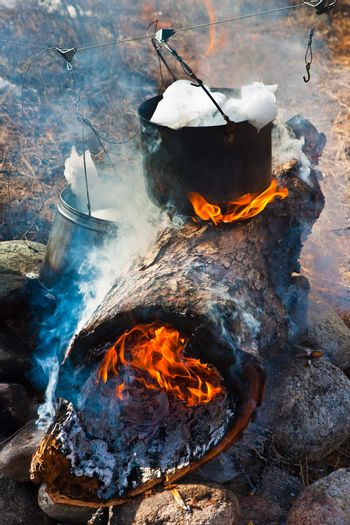 Preparation of meal on a fire