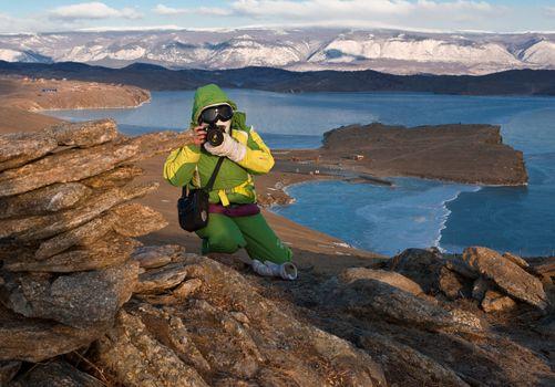 The girl the photographer on mountain about Baikal