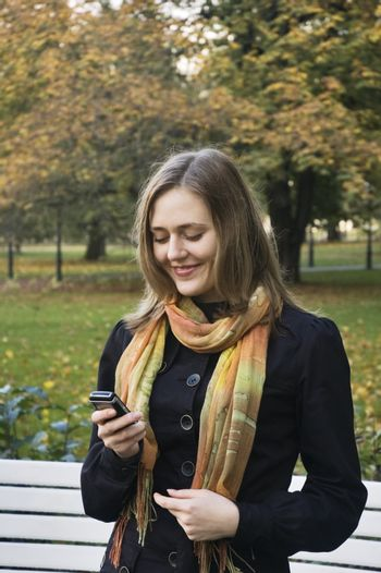 The smiling girl with mobile phone