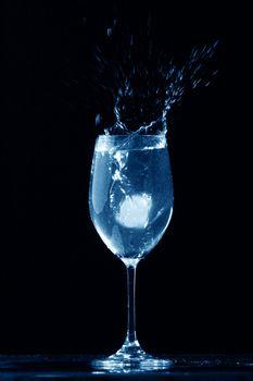 alcohol splash on black  background
