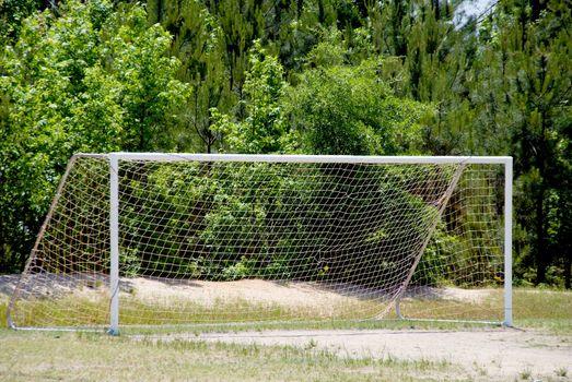 A soccer goal set up on a grassy field.