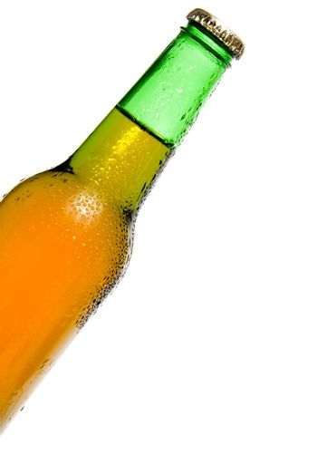 An ice cold beer in a bottle.