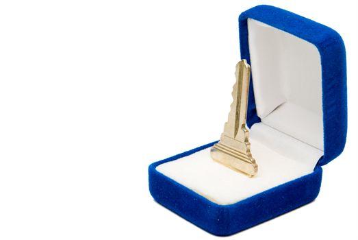 A house key in a jewlers box.