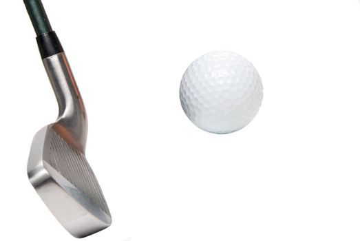 A golfer's iron and a white golf ball.