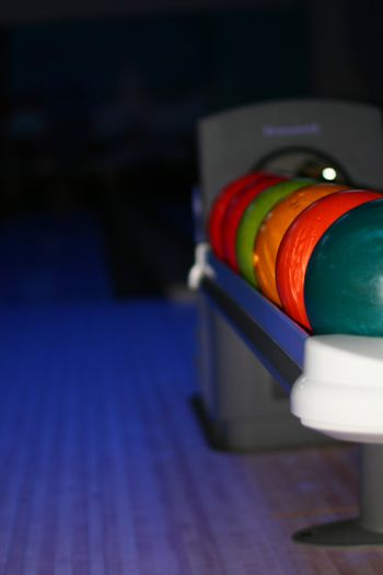 colored bowling bolls in a row