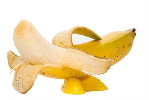 A bright yellow banana with vivid yellow feet.