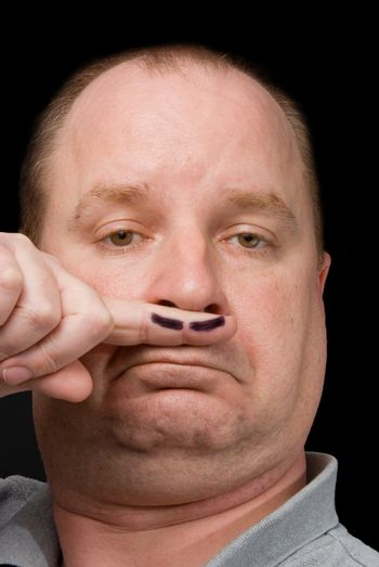 A man sporting a fake moustache on his finger.