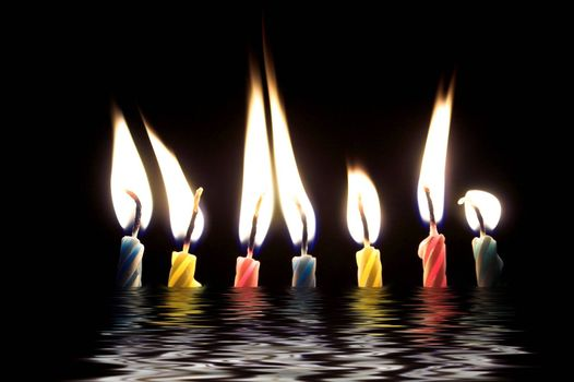 Several wax candles typically used for birthday celebrations.
