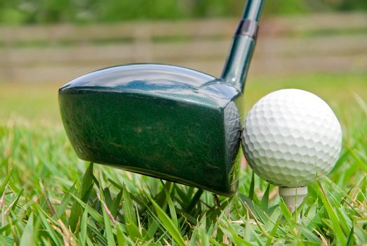 A driver just before it hits a golf ball.