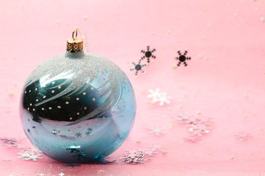christmas card ball on pink background